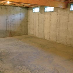 A cleaned out basement in Ithaca, shown before remodeling has begun
