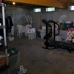 An unfinished basement filled with clutter in Utica.