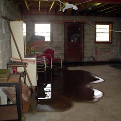 A flooded basement showing groundwater intrusion in Syracuse