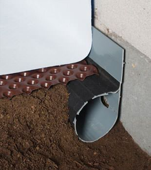 Closeup of a crawl space drainage system installed in Camillus