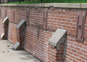 Rusted wall plate anchors in a retaining wall repair in Liverpool, Syracuse, Ithaca, Utica.