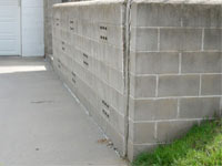 A retaining wall separating from the adjoining walls in Syracuse, Ithaca, Utica, Binghampton