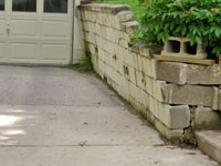 a failing retaining wall around a driveway in Syracuse