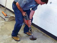 Coring the concrete of a concrete slab floor in Cortland
