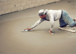 smoothing out the grout in a slab releveling project in Rome