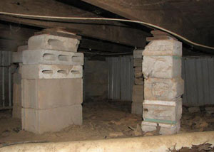crawl space repairs done with concrete cinder blocks and wood shims in a Canandaigua home