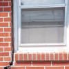 A gap in a window along the outer wall due to foundation settlement of a Baldwinsville home.