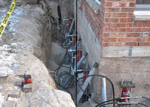 Foundation push piers installed around a house with a foundation settlement issues in Camillus