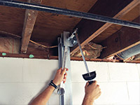 Straightening a foundation wall with the PowerBrace™ i-beam system in a Auburn home.