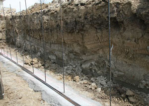 Soil layers exposed while excavating to construct a new foundation in Oswego