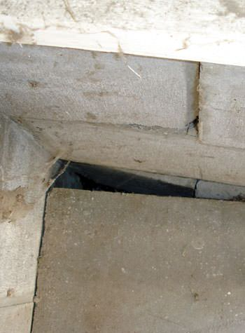 inward rotation of a foundation wall damaged by street creep in a garage in Ogdensburg