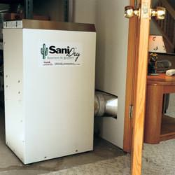 A basement dehumidifier with an ENERGY STAR® rating ducting dry air into a finished area of the basement  in New Hartford
