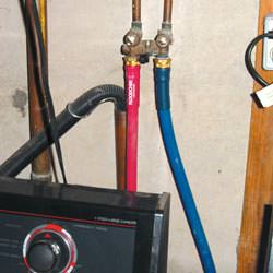 Washer hoses in a basement  in Ithaca, Binghampton, Utica, Syracuse